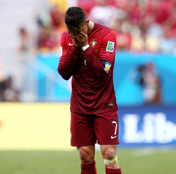 Cristiano Ronaldo of Portugal looks dejected after the World Cup Group G match against Ghana