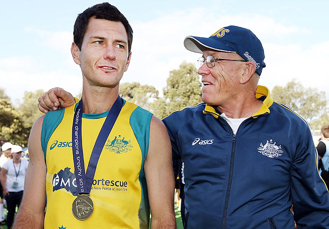 Jamie Dwyer of Australia is hugged by Rick Charlesworth