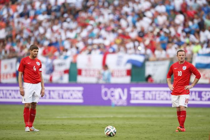 Steven Gerrard and Wayne Rooney of England prepare to take a free-kick during the international friendly match between England and Honduras at the Sun Life Stadium on June 7, 2014 in Miami Gardens, Florida.