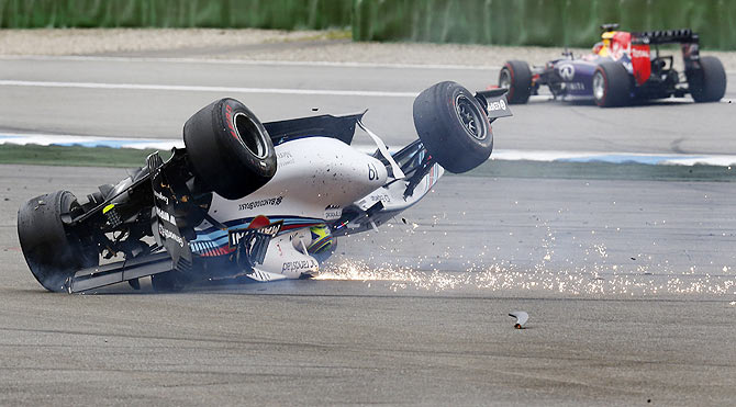 Williams Formula One driver Felipe Massa of Brazil crashes with his car in the first corner after the start of the German F1 Grand Prix at the Hockenheim racing circuit on Sunday