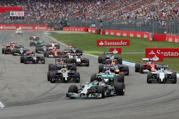 Nico Rosberg of Germany and Mercedes GP leads the field into the first corner during the German Grand Prix on Sunday
