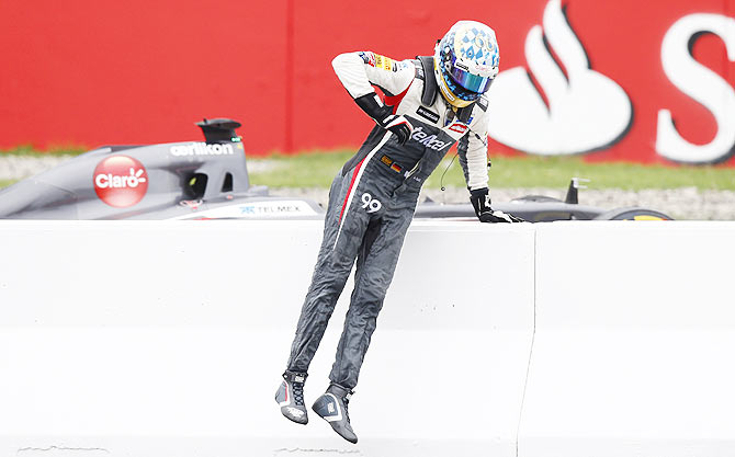 Sauber Formula One driver Adrian Sutil of Germany leaves the track after having technical problems with his car during the German F1 Grand Prix on Sunday