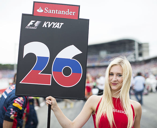 Rediff Sports - Cricket, Indian hockey, Tennis, Football, Chess, Golf - F1 PHOTOS: Grid girls at German GP make good distraction!