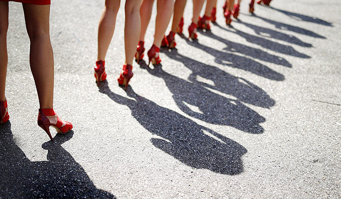 Grid girls are lined up after the qualifying ahead of the German F1 Grand Prix at the Hockenheim racing circuit on Saturday