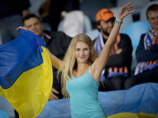 An FC Shakhtar Donetsk supporter cheers during a match