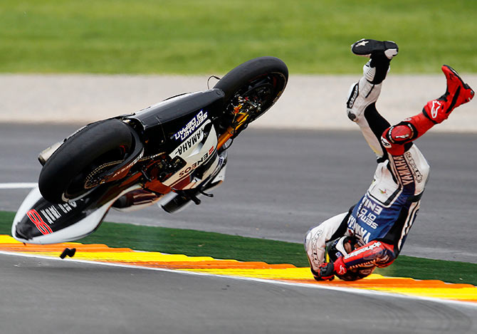Yamaha MotoGP world champion rider Jorge Lorenzo falls