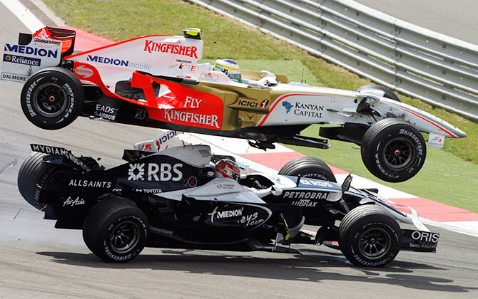 Force India Formula One driver Giancarlo Fisichella of Italy (top) clashes with Williams driver Kazuki Nakajima of Japan