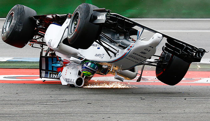 Williams driver Felipe Massa of Brazil crashes on the first corner after the start of the German F1 Grand Prix