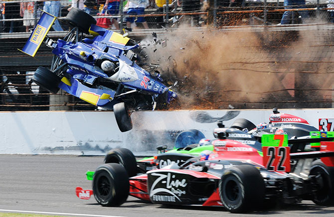 Dreyer & Reinbold Racing driver Mike Conway flies through the air after crashing with a fellow driver