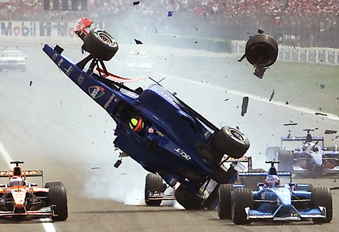 Brazilian Luciano Burti crashes his Prost car