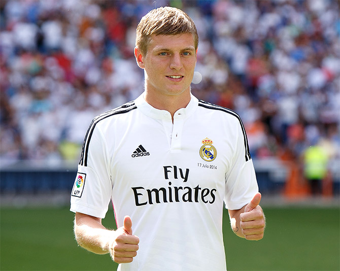 Toni Kroos poses in his new Real Madrid shirt during his official unveiling at Santiago Bernabeu Stadium