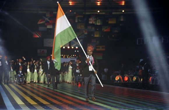 India's flag is carried by Vijay Kumar during the opening ceremony for the 2014 Commonwealth Games at Celtic Park in Glasgow