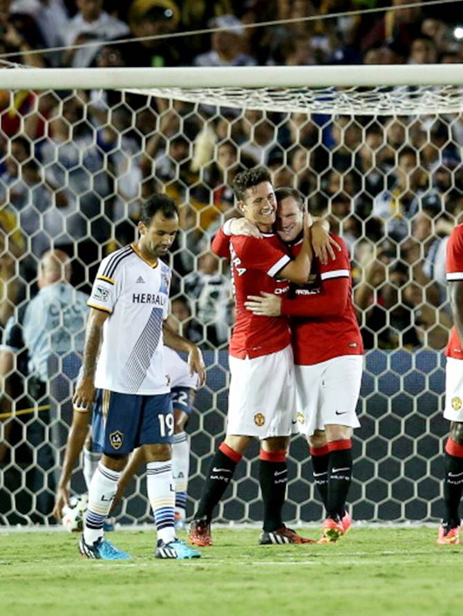 Wayne Rooney (right) of Manchester United celebrates with Ander Herrera after scoring from a penalty kick as Juninho (#19) of the Los Angeles Galaxy reacts