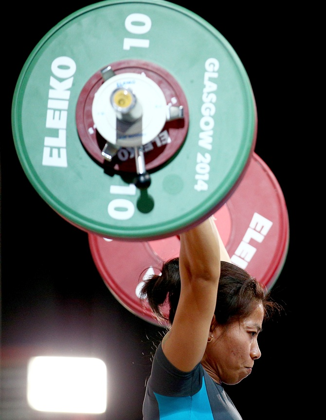 Sanjita Chanu Khumukcham of India competes in the Clean and Jerk on her way to winning the gold medal in the women's 48kg weightlifting at the Scottish Exhibition And Conference Centre during Day 1 of the Glasgow 2014 Commonwealth Games