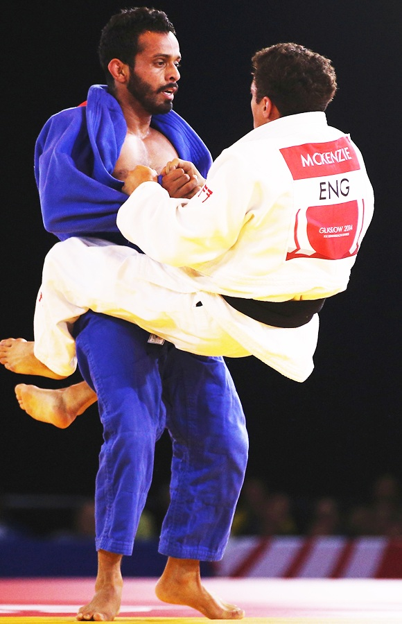 Navjot Chana of India competes against Ashley McKenzie of England in the men's 60kg gold medal contest at SECC Precinct