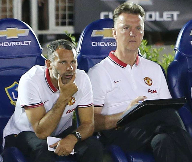 Manchester United's assistant manager Ryan Giggs (left) with new boss Louis van Gaal