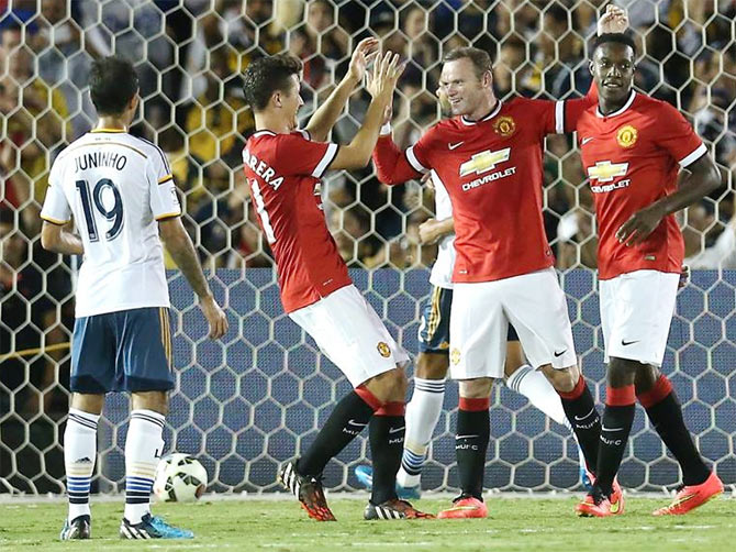 Wayne Rooney and Danny Wellbeck celebrate with Ander Herrera during the match against LA Galaxy