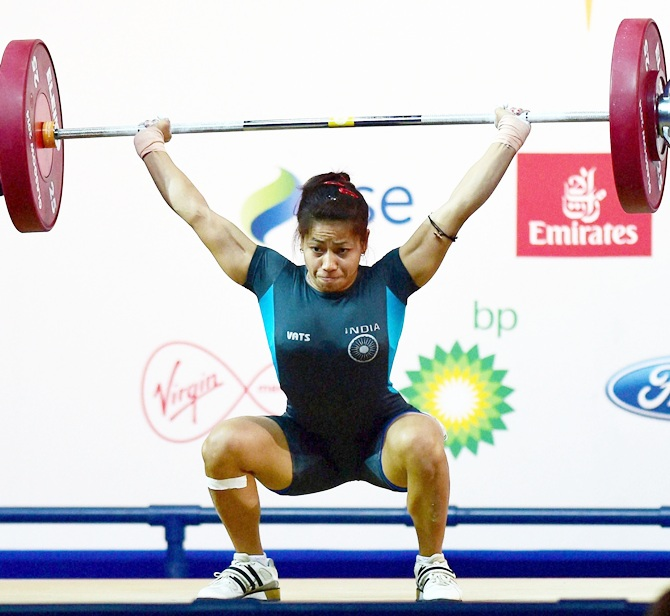 India's Sanjita Khumukcham completes a lift during the 48-kg womens weightlifting event at the Commonwealth Games in Glasgow