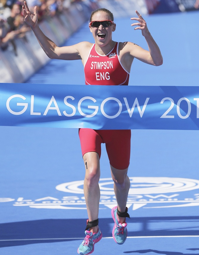 Jodie Stimpson of England celebrates after winning the Women's Triathlon at Strathclyde   Country Park during day one of the Glasgow 2014 Commonwealth Games