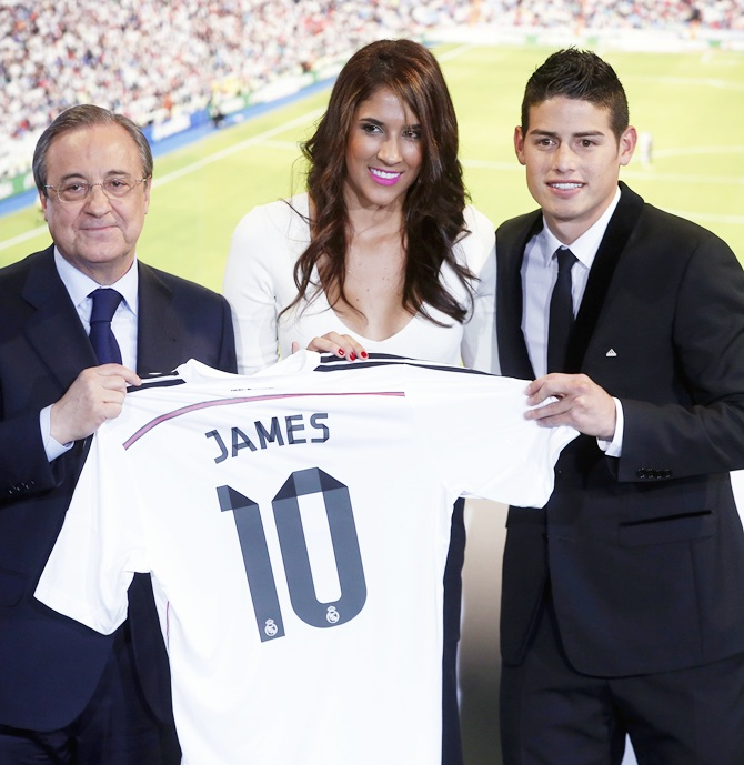 Colombia's soccer player James Rodriguez, right, stands with his wife Daniela and Real Madrid president Florentino Perez
