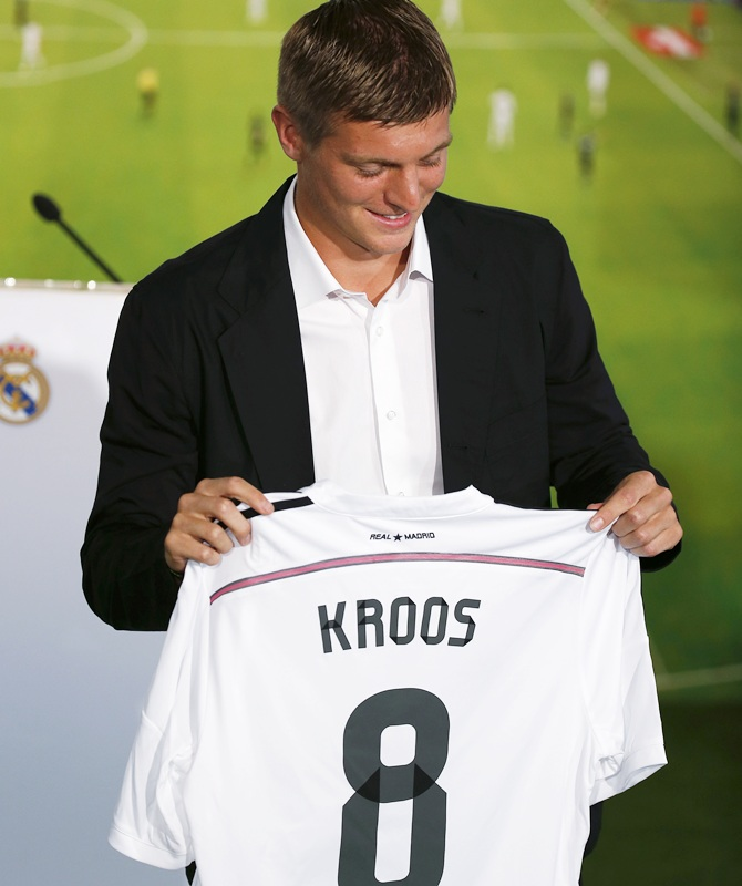 Midfielder Toni Kroos of Germany poses holding his new Real Madrid shirt