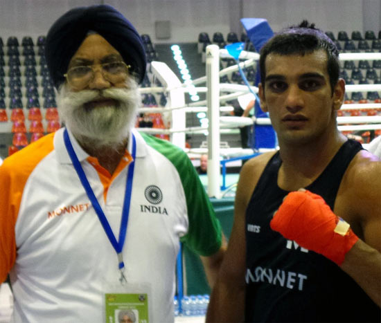 Mandeep Jangra (right) with Indian national boxing coach GS Sandhu