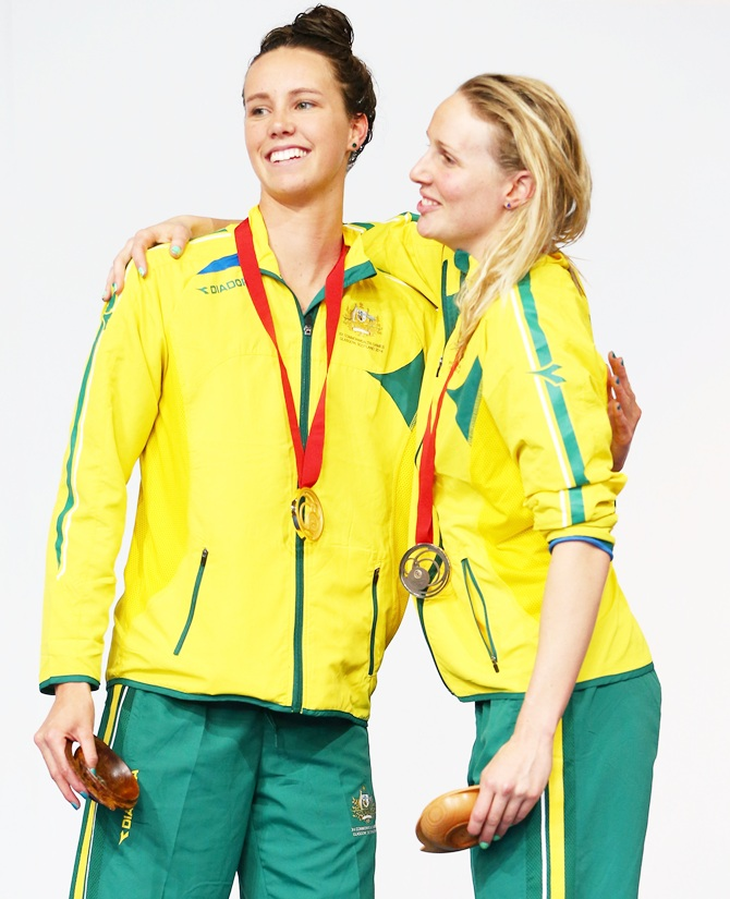 Gold medallist Emma McKeon, left, of Australia poses with bronze medallist Bronte Barratt of Australia during the medal ceremony for the Women's 200m Freestyle Final