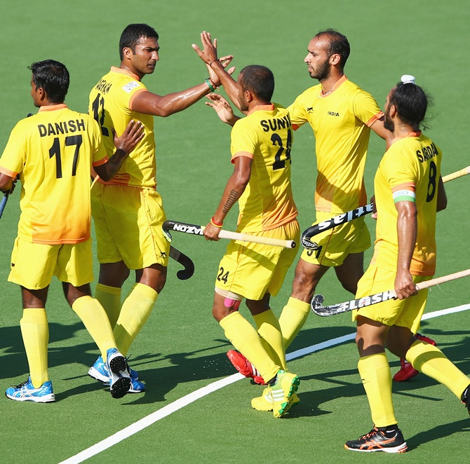 VR Raghunath of India celebrates after scoring from a penalty corner during the Mens   Hockey match between India and Wales at Glasgow National Hockey Centre during day two of   the Glasgow 2014 Commonwealth Games