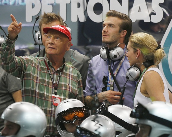 David Beckham (second right) watches with Niki Lauda