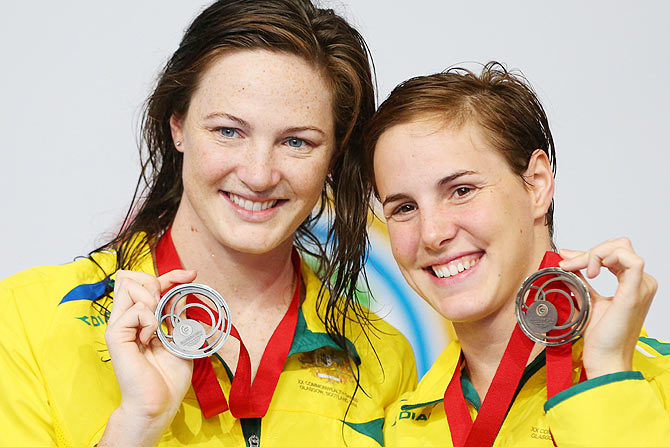Silver medallist Cate Campbell (left) of Australia and bronze medallist Bronte Campbell of Australia pose during the medal ceremony for the Women's 50m Freestyle Final at Tollcross International Swimming Centre on Saturday