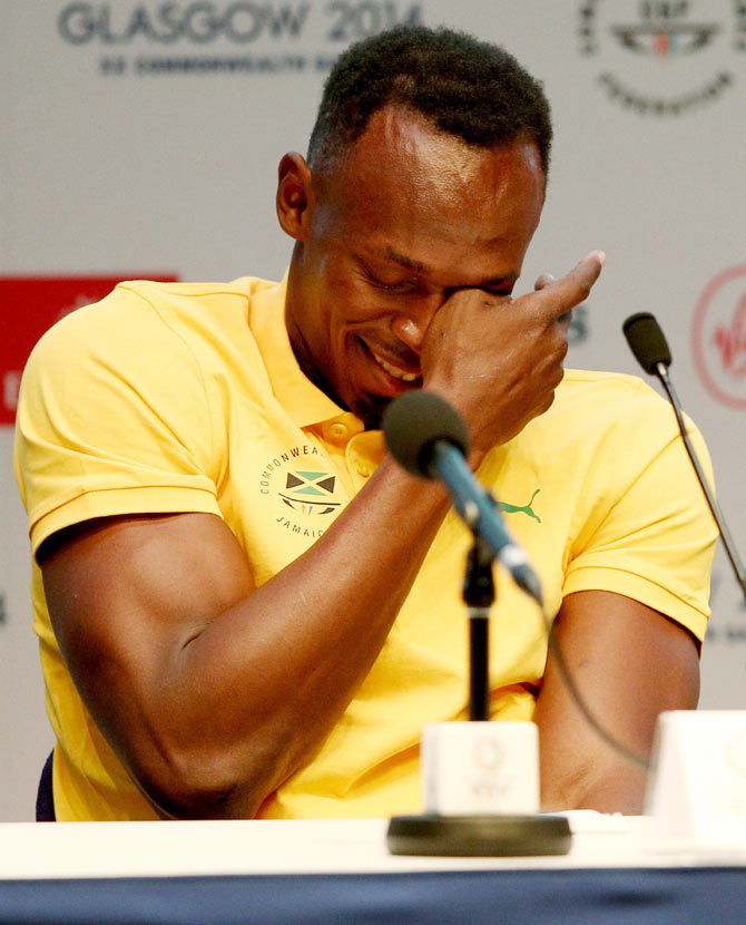 Athlete Usain Bolt of Jamaica reacts to a question as he attends a press conference and photocall at the Main Press Centre (MPC) on Saturday
