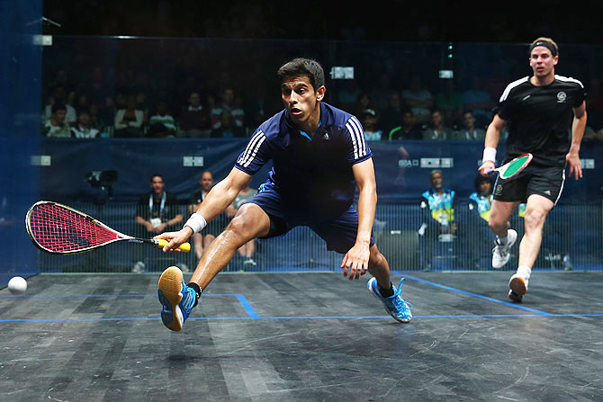 Campbell Grayson of New Zealand and Saurav Ghosal of India (left) in action during the quarter-finals of the Men's Squash at Scotstoun Sports Campus during day three of the Glasgow 2014 Commonwealth Games on Saturday