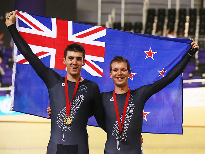 Gold medalist Tom Scully of New Zealand (ledt) and bronze medalist Aaron Gate of New Zealand celebrate during the medal ceremony for the Men's 40km Points Race final at Sir Chris Hoy Velodrome on Saturday