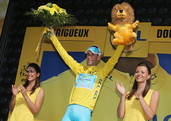 Vincenzo Nibali of Italy and the Astana Pro Team takes the podium after defending the overall race leader's jersey with a fourth place finish in the individual time trial during the twentieth stage of the 2014 Tour de France, a 54km individual time trial stage between Bergerac and Perigueux on Sunday