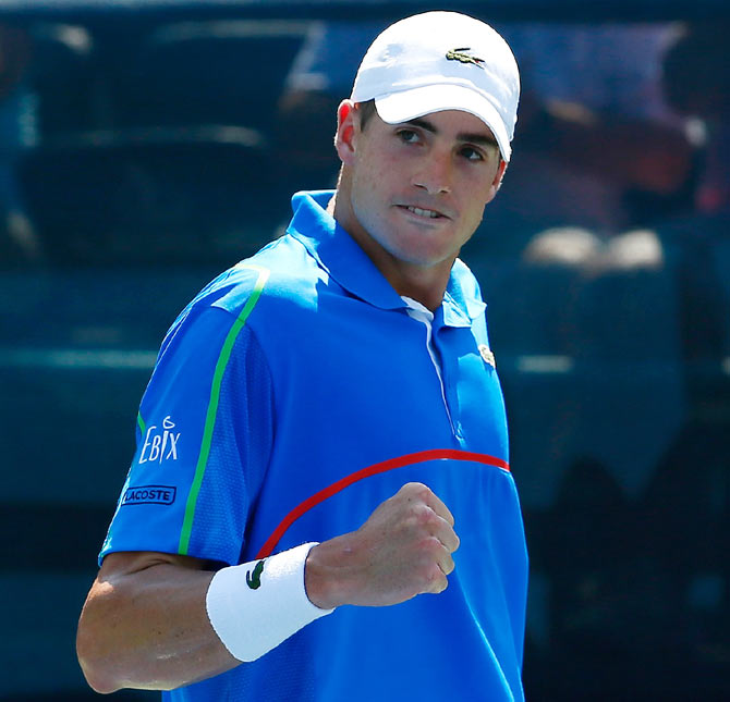 John Isner reacts after winning the first set against Jack Sock during the BB&T Atlanta Open at Atlantic Station on Saturday