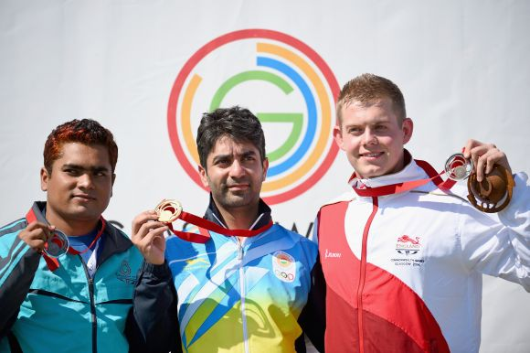 Abdulah Baki of Bangladesh, Abhinav Bindra of India and Daniel Rivers of England,   receive their medals following competing in the mens 10m Air Rifle at Barry Buddon Shooting   Centre during day two of the Glasgow 2014 Commonwealth Games