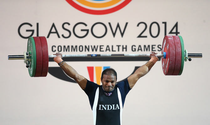 Sathish Sivalingam of India wins gold in the Men's Weightlifting 77kg category at Scottish Exhibition And Conference Centre during day four of the Glasgow 2014 Commonwealth Games on Sunday