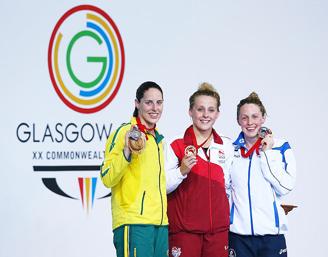 Gold medallist Siobhan O'Connor of England poses with silver medallist Alicia Coutts of Australia and bronze medallist Hannah Miley of Scotland during the medal ceremony for the Women's 200m Individual Medley Final at Tollcross International Swimming Centre on Sunday