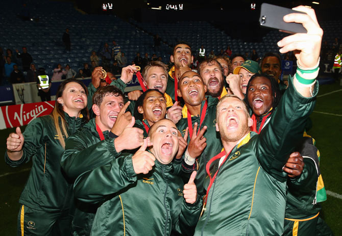 The South Africa team take a selfie after winning the Rugby final against New Zealand to take gold at Ibrox Stadium on Sunday