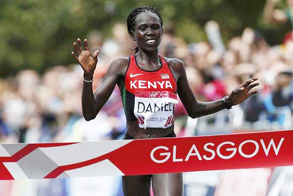 Kenya's Flomena Cheyech Daniel crosses the finish line to win the women's marathon gold medal at the 2014 Commonwealth Games in Glasgow on Sunday