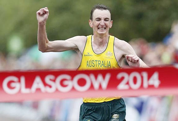 Michael Shelley of Australia celebrates as he crosses the finish line to win the men's marathon gold medal at the 2014 Commonwealth Games in Glasgow on Sunday