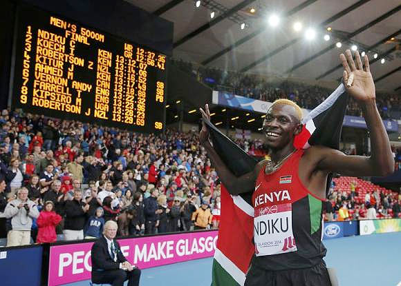 Kenya's Caleb Mwangangi Ndiku celebrates after winning the men's 5000m final at the 2014 Commonwealth Games in Glasgow on Sunday