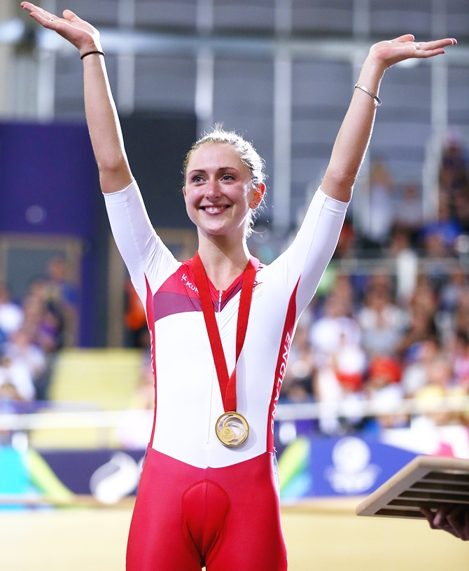 Laura Trott of England celebrates with her gold medal