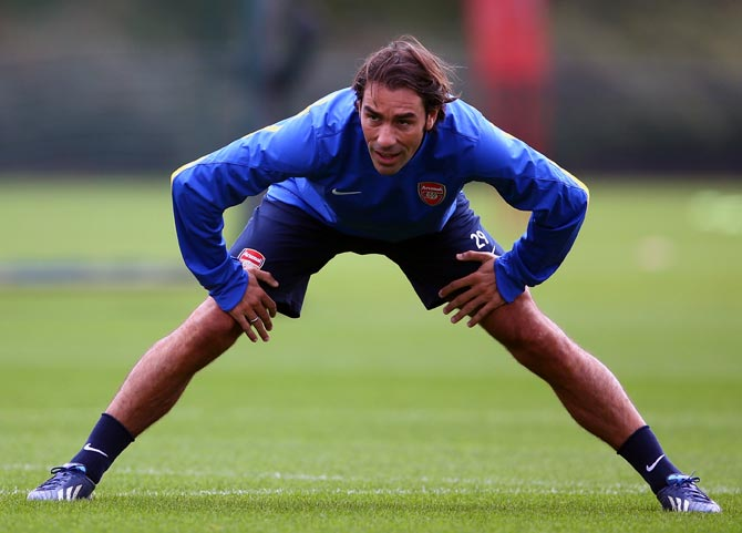 Robert Pires warms up during an Arsenal training session