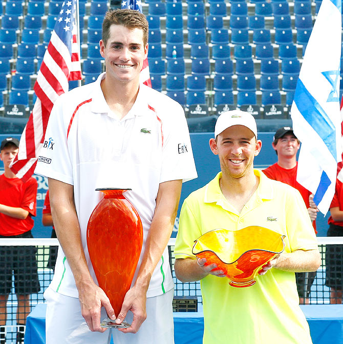 John Isner and Dudi Sela of Israel pose with their trophies after the finals of the BB&T Atlanta Open at Atlantic Station on Sunday