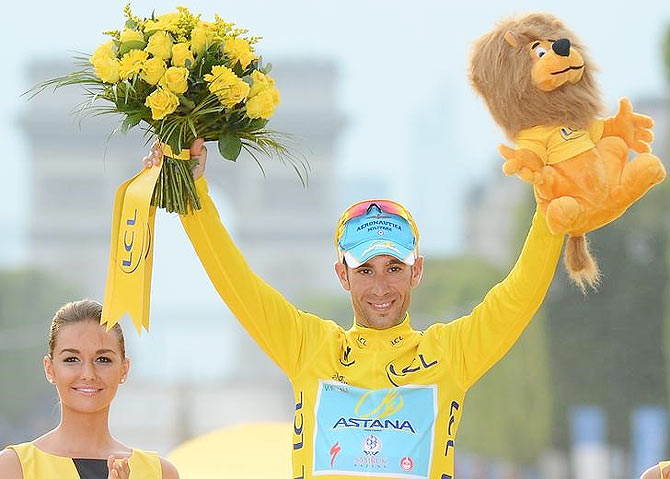 Astana team rider Vincenzo Nibali of Italy celebrates his overall victory on the podium after the 137.5 km final stage of the 2014 Tour de France, from Evry to Paris Champs Elysees on Sunday
