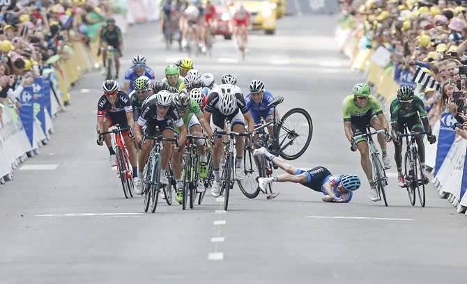Garmin-Sharp team rider Andrew Talansky of the US crashes as   Omega Pharma-Quick Step team rider Matteo Trentin of Italy (left,front) sprints to win the   234.5 km seventh stage of the Tour de France cycling race from Epernay to Nancy on July 11