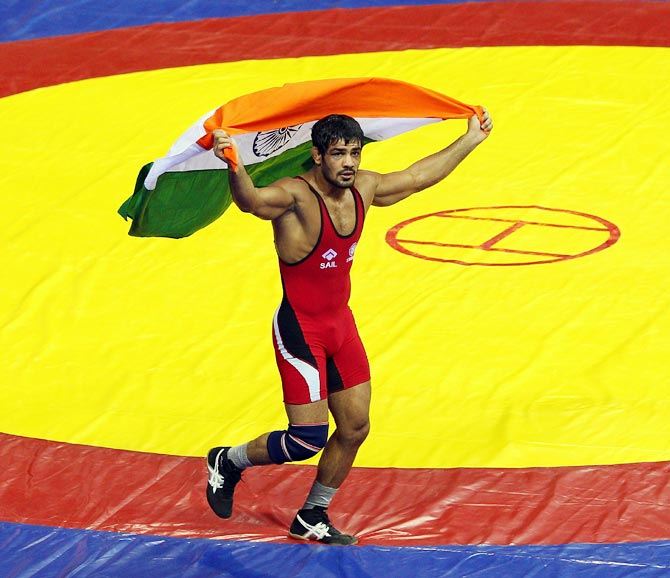 Sushil Kumar of India celebrates after winning the gold medal at the 2010 Commonwealth Games in Delhi