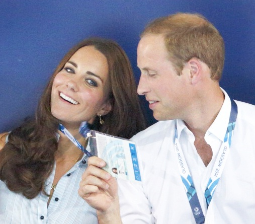 Duchess of Cambridge, sits with her husband Prince William