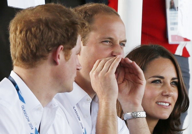 Catherine, Duchess of Cambridge, sits with her husband Britain's Prince William, right,  and Britain's Prince Harry as they watch artistic gymnastics